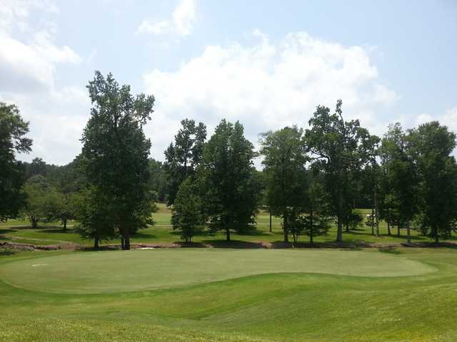 A sunny day view of a green at Northwoods Golf Course