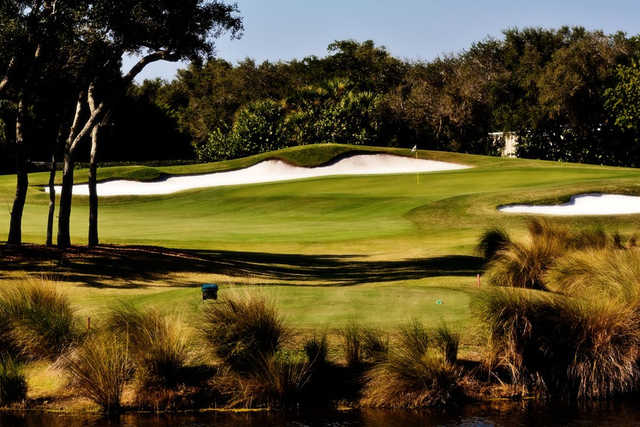 A view of a green protected by sand traps at Grand Harbor Golf & Beach Club