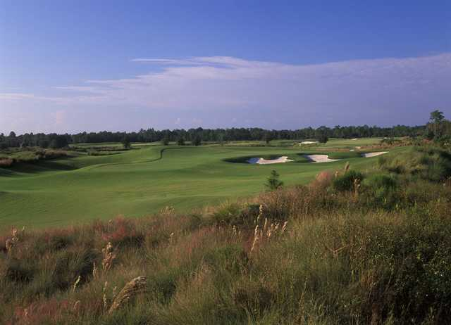 A view of a green protected by sand traps at Golf Club of the Everglades