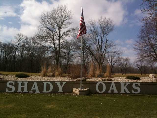 A view of the entrance sign at Shady Oaks Country Club