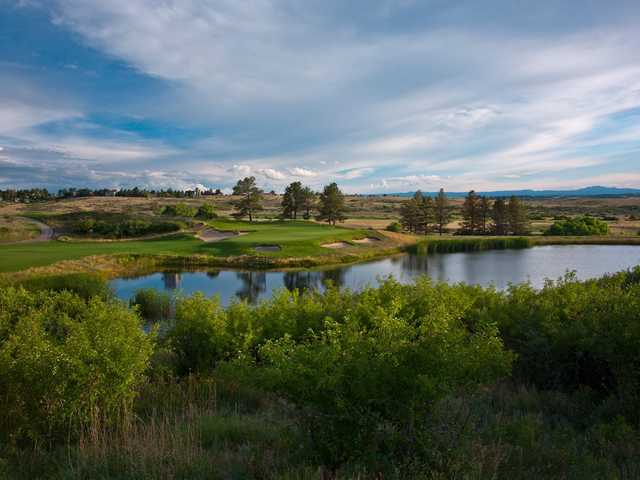 A view of a green with water and bunkers coming into play at Colorado Golf Club