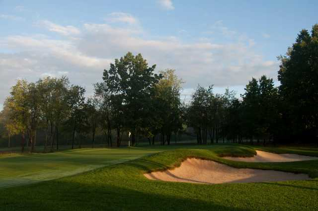 A view of a hole protected by bunkers from  Warren Golf Course At Notre Dame