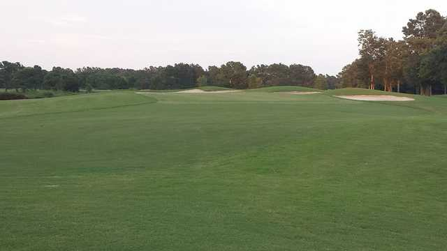 View of a green and bunkers at Meadowlands Golf Course