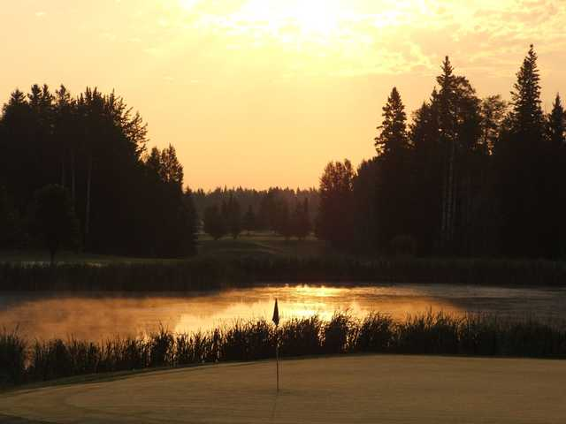 A view of a green with water coming into play at Edson Golf and Country Club