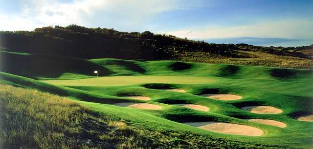 A view of a green protected by a collection of bunkers at Red Hawk Ridge