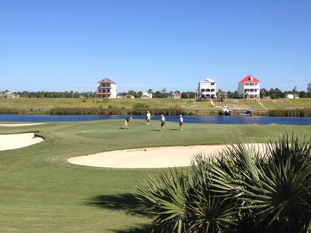 A view of a green with water and bunkers coming into play at Myrtlewood Golf Club