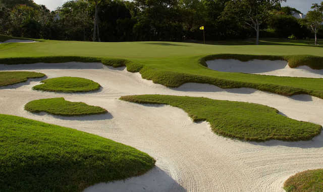 A view of a hole protected by tricky bunkers at Pine Tree Golf Club