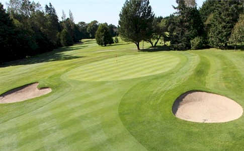 A view of a hole flanked by bunkers at Foxrock Golf Club