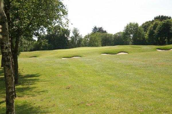 A view of green #8 surrounded by bunkers at St. Mellons Golf Club