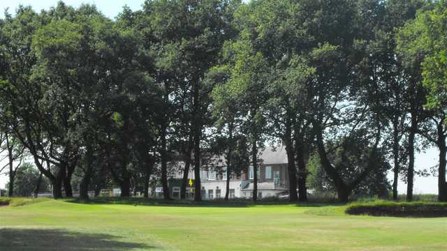 A sunny day view of a green at Whittington Heath Golf Club