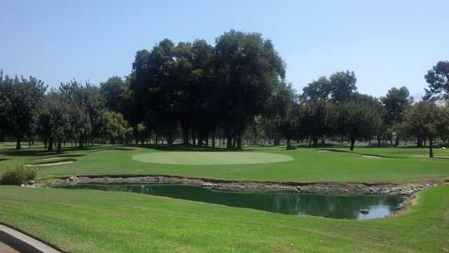 A view of a hole with bunkers on the left at El Dorado Park Golf Club.