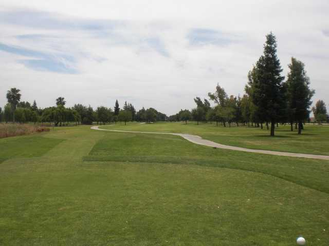 A view from Madera Municipal Golf Course with narrow road on the right