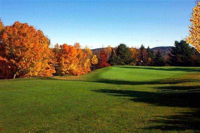 A fall day view of a green at Westfield Group Country Club
