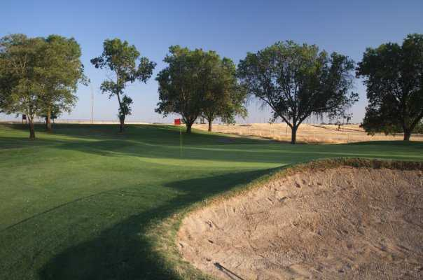 A green view with huge bunker on the right at Mather Golf Course