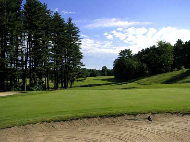 A view of a green protected by bunkers at Stow North from Stow Acres Country Club