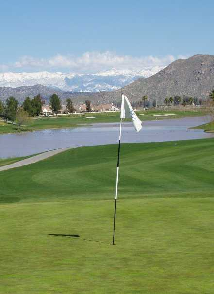 A view of a hole with water in background at Menifee Lakes Country Club