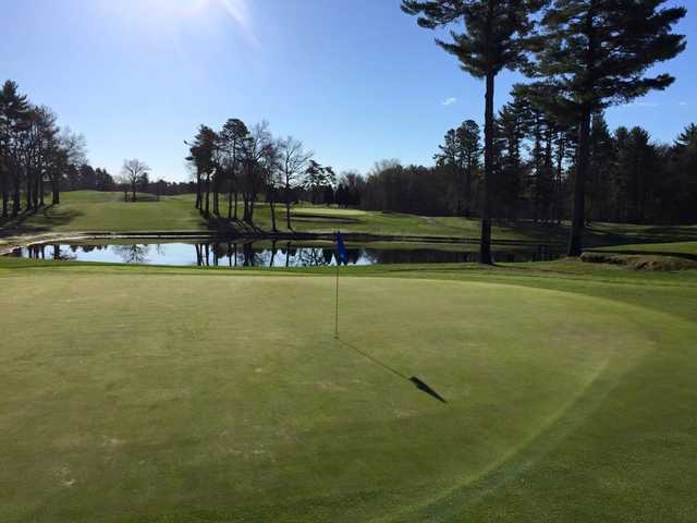A view of a hole guarded by a pond at Veterans Memorial Golf Course