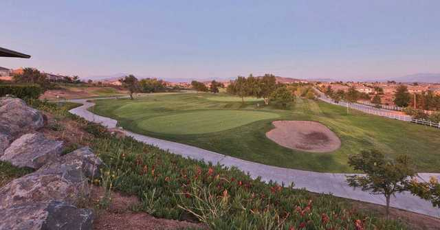 A view of a hole with a bunker on the right and narrow road in foreground at The Golf Club from Rancho California