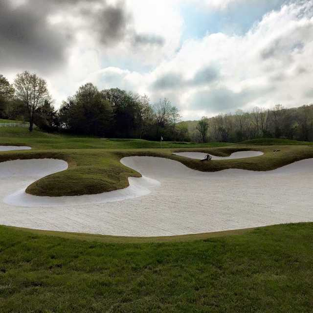 A view of a hole protected by tricky bunkers at Country Club of St. Albans