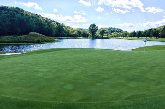 A view of a green with water coming into play at Country Club of St. Albans.