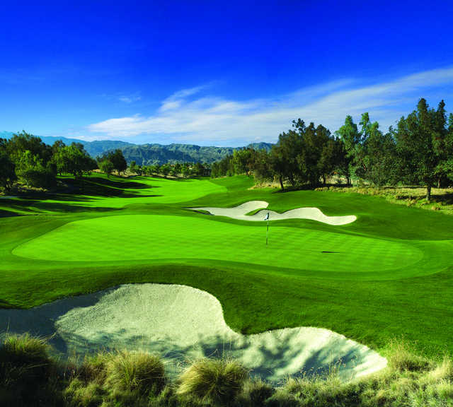 A view of the 1st hole surrounded by bunkers at Shadow Ridge Golf Club