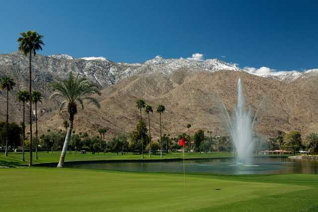 A view of the 9th green with Disney Fountain and snow capped San Jacinto mountains in the background at North Course from Indian Canyons Golf Resort.