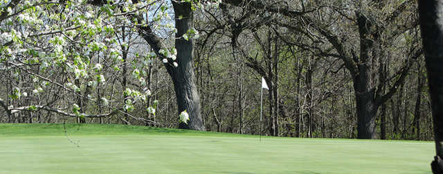 A spring day view of a hole at Riverside Golf Course