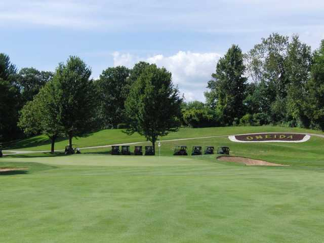 A view of a green protected by bunkers at Oneida Golf and Country Club