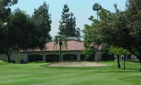 A view of the clubhouse with bunker in foreground at Brookside Golf Club