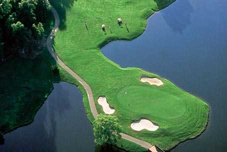 Aerial view of green surrounded by water at Ford's Colony at Williamsburg - Marsh Hawk Course