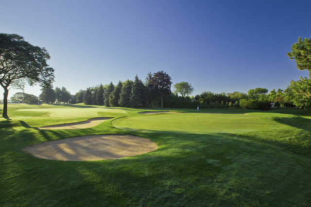 A view of green #3 protected by tricky bunkers at University Club of Milwaukee.