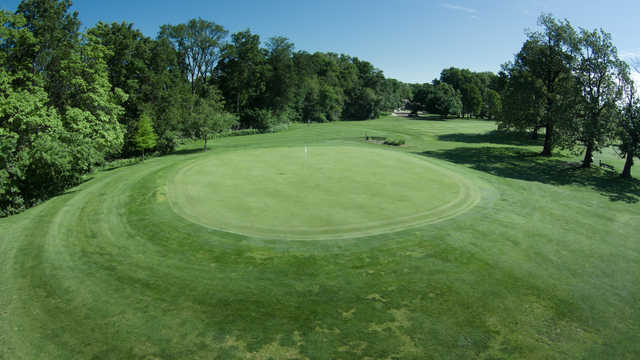 A sunny day view of a hole at Madison Golf Course