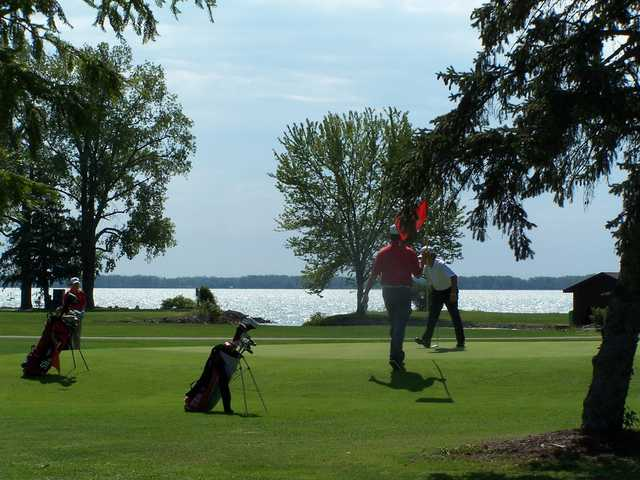 A view of a green at with water in background at Northmoor Golf Club