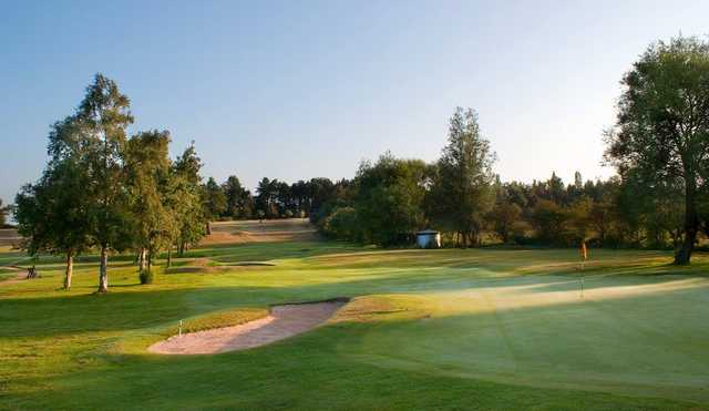 A view of a hole protected by bunkers at North Warwickshire Golf Club
