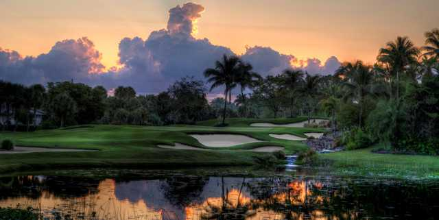 A view of a green protected by a collection of tricky bunkers at Boca West Country Club