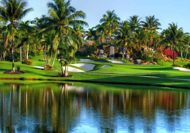 A view of a hole with water and bunkers into play at Boca West Country Club