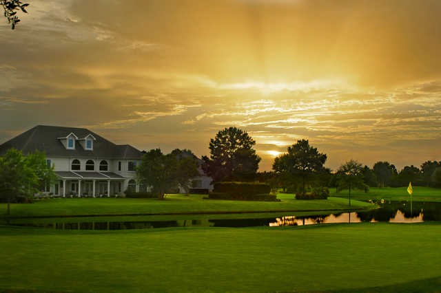 A view of a hole and the clubhouse at Craft Farms Resort