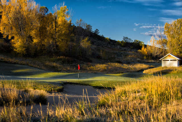 A view of a green protected by bunkers at Eagle Ranch Golf Club
