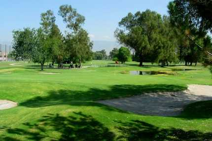A view of a green surrounded by bunkers at San Bernardino Golf Club.
