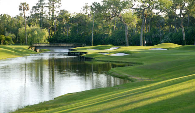 A view of a green with water and bunkers coming into play from Plantation at Ponte Vedra