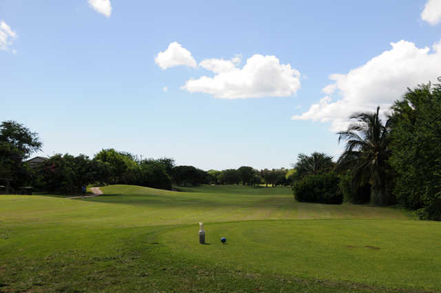 View of a fairway and green at Coral Creek Golf Course