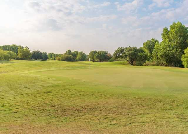View of a green at Hawks Creek Golf Club.