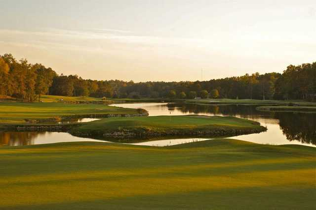 A view of the 18th green surrounded by water from the Blackheath Course at Ford's Colony at Williamsburg