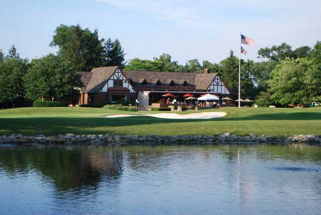 A view of a hole and the clubhouse in background at Trumbull Country Club