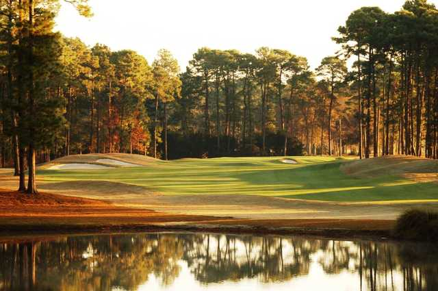 A sunny day view of a hole at Hilton Head National Golf Club