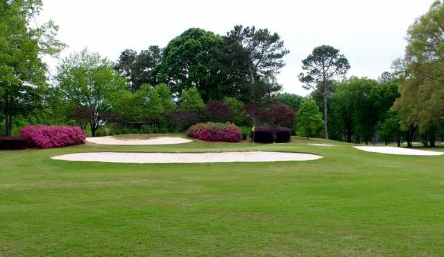 A view of a green protected by bunkers at Coosa Country Club