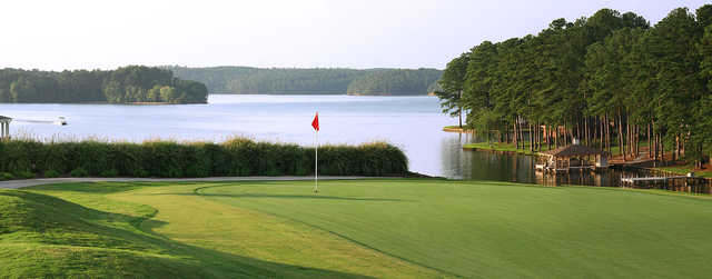 A view of a hole with water in background at Milledgeville Country Club
