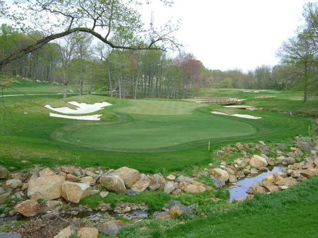 A view of a green flanked by sand traps at Rock Manor Golf Club