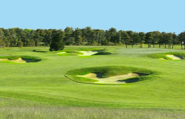 A view of a green protected by bunkers at Miacomet Golf Club