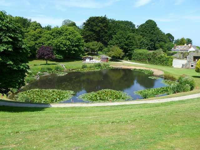 View of a green and pond at The St. Pierre Park Hotel & Golf Resort